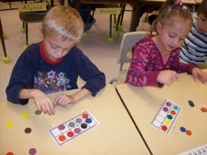 Children putting counters on a ten frame