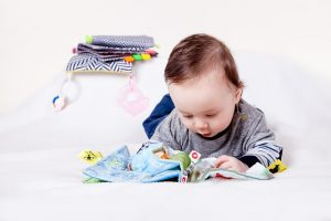Baby reading a book.