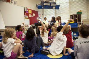 Children sitting on classroom floor